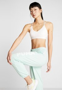 Puma - MODERN SPORTS PANTS - Verryttelyhousut - mist green - 4