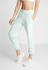 Puma - MODERN SPORTS PANTS - Verryttelyhousut - mist green - 0