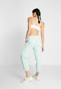 Puma - MODERN SPORTS PANTS - Verryttelyhousut - mist green - 2