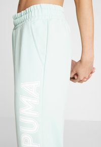 Puma - MODERN SPORTS PANTS - Verryttelyhousut - mist green - 5