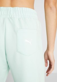 Puma - MODERN SPORTS PANTS - Verryttelyhousut - mist green - 7