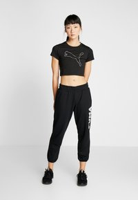 Puma - MODERN SPORTS PANTS - Tracksuit bottoms - puma black - 1