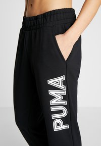 Puma - MODERN SPORTS PANTS - Tracksuit bottoms - puma black - 6