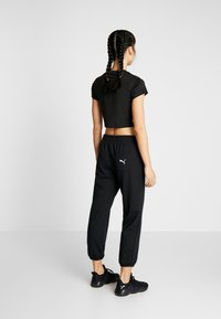Puma - MODERN SPORTS PANTS - Tracksuit bottoms - puma black - 2