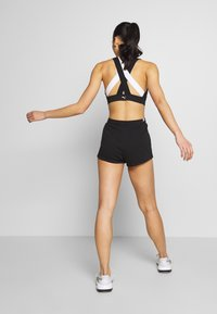 Puma - AMPLIFIED - Sports shorts - black - 2