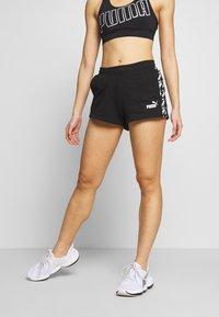 Puma - AMPLIFIED - Sports shorts - black - 0