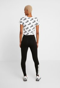 Puma - REBEL LEGGINGS - Collant - black - 2