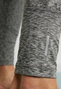 Puma - STUDIO TAPERED PANT - Pantalon de survêtement - medium gray heather - 5
