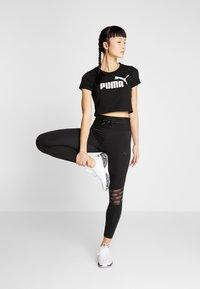 Puma - FEEL IT 7/8  - Tights - puma black - 1