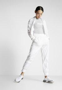 Puma - PUMA PANT - Tracksuit bottoms - white - 1