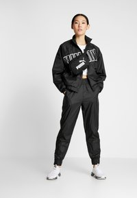 Puma - PUMA PANT - Trainingsbroek - puma black - 1