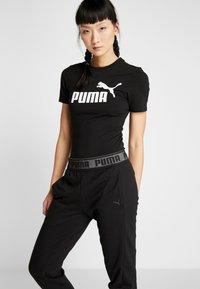 Puma - LOGO PANT - Teplákové kalhoty - black - 3