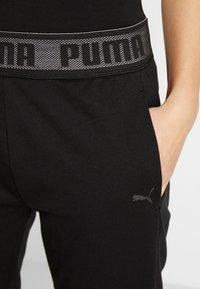 Puma - LOGO PANT - Teplákové kalhoty - black - 5