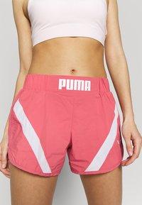 Puma - STUDIO CLASH ACTIVE SHORTS - Sports shorts - rapture rose - 3