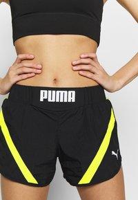Puma - STUDIO CLASH ACTIVE SHORTS - Sports shorts - black - 3