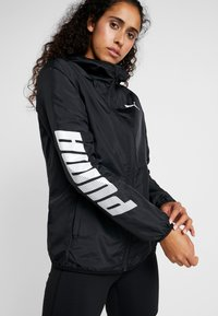 Puma - GRAPHICS - Trainingsjacke - black - 5