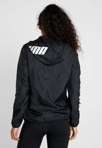 Puma - GRAPHICS - Trainingsjacke - black - 2