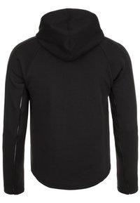 Puma - EVOSTRIPE MOVE KAPUZEN - Sports jacket - black - 1