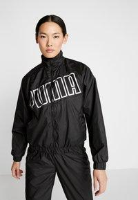 Puma - FEEL IT - Training jacket - puma black - 0