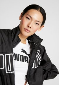 Puma - FEEL IT - Training jacket - puma black - 4