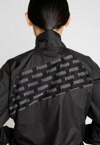 Puma - FEEL IT - Training jacket - puma black - 7