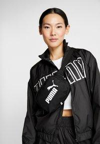 Puma - FEEL IT - Training jacket - puma black - 3
