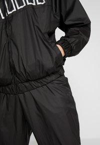 Puma - FEEL IT - Training jacket - puma black - 5