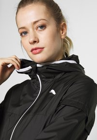 Puma - ESSENTIALS SOLID  - Veste coupe-vent - black - 4