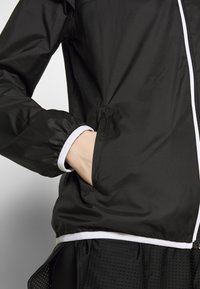 Puma - ESSENTIALS SOLID  - Veste coupe-vent - black - 3