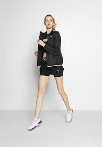Puma - ESSENTIALS SOLID  - Veste coupe-vent - black - 1