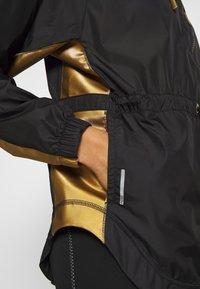 Puma - METAL SPLASH ANORAK - Training jacket - black - 5
