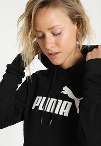 Puma - ESS LOGO HOODY  - Sweat à capuche - cotton black - 3