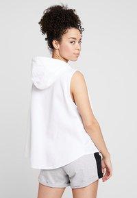 Puma - EVOSTRIPE LITE  HOODED - Waistcoat - white - 2