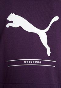 Puma - NU TILITY HOODY - Collegetakki - plum purple - 6