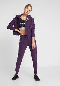 Puma - NU TILITY HOODY - Collegetakki - plum purple - 1