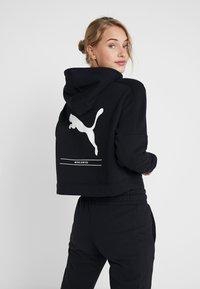 Puma - NU TILITY HOODY - Zip-up hoodie - puma black - 2