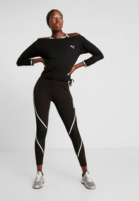 Puma - PAMELA REIF X PUMA OFF SHOULDER SWEAT - Funkční triko - black - 1