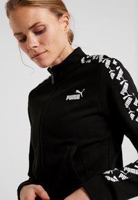 Puma - AMPLIFIED TRACK JACKET  - Zip-up hoodie - black