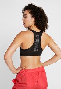 Puma - Sports bra - black - 2