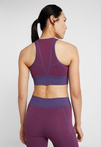 Puma - SEAMLESS BRA - Sport BH - imperial palace/persian red