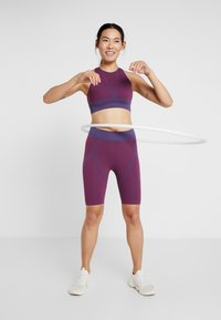 Puma - SEAMLESS BRA - Sports bra - imperial palace/persian red - 1