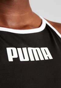 Puma - PAMELA  REIF X PUMA CROP TOP - Sports shirt - black - 5