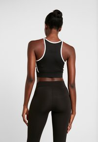 Puma - PAMELA  REIF X PUMA CROP TOP - Sports shirt - black - 2