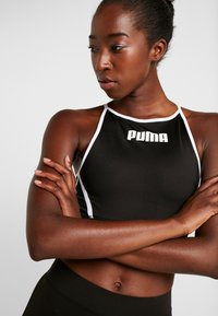 Puma - PAMELA  REIF X PUMA CROP TOP - Sports shirt - black - 3