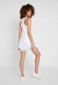 Puma - PERFORMANCE DRESS - Sportovní šaty - white - 2