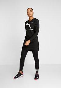 Puma - NU TILITY DRESS - Sports dress - black - 1