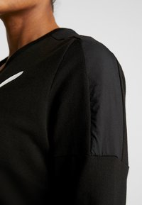 Puma - NU TILITY DRESS - Sports dress - black - 5