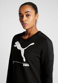 Puma - NU TILITY DRESS - Sports dress - black - 3