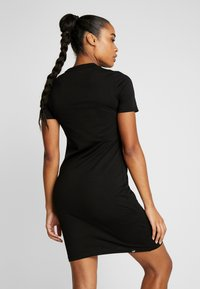 Puma - FITTED DRESS - Robe en jersey - black - 2