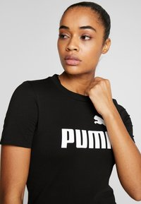 Puma - FITTED DRESS - Robe en jersey - black